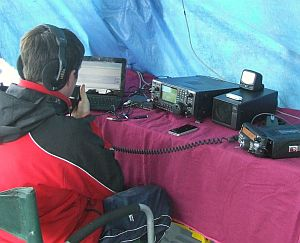 A Radio Amateur operating M0KRG portable station inside a tent